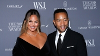 Chrissy Teigen and John Legend wearing all black at an event