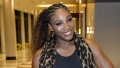 Serena williams exercises while holding Alexis Olympia