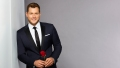 Colton Underwood with a rose