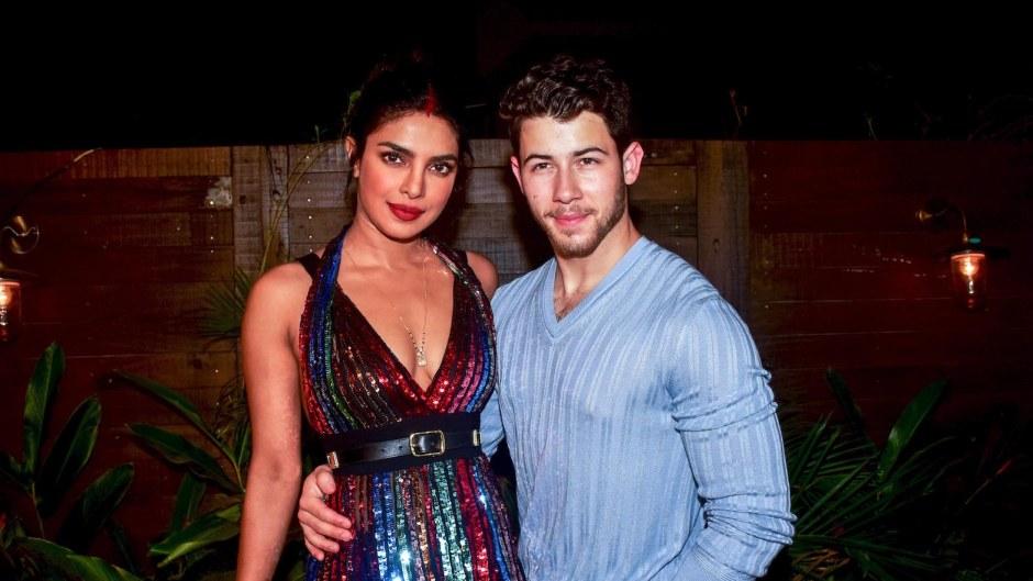 Priyanka Chopra with Nick Jonas, wearing blue and Priyanka wearing a multi-colored dress