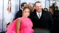 Jennifer Lopez wearing a hot pink dress with Alex Rodriguez