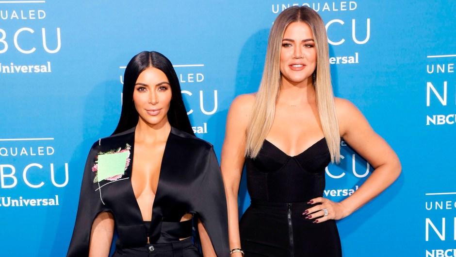 Khloe Kardashian and Kim Kardashian wearing all black
