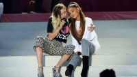 Miley Cyrus texted Ariana Grande emojis after her break up with Pete Davidson