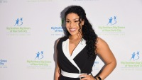 Jordin Sparks wearing a black and white dress at an event