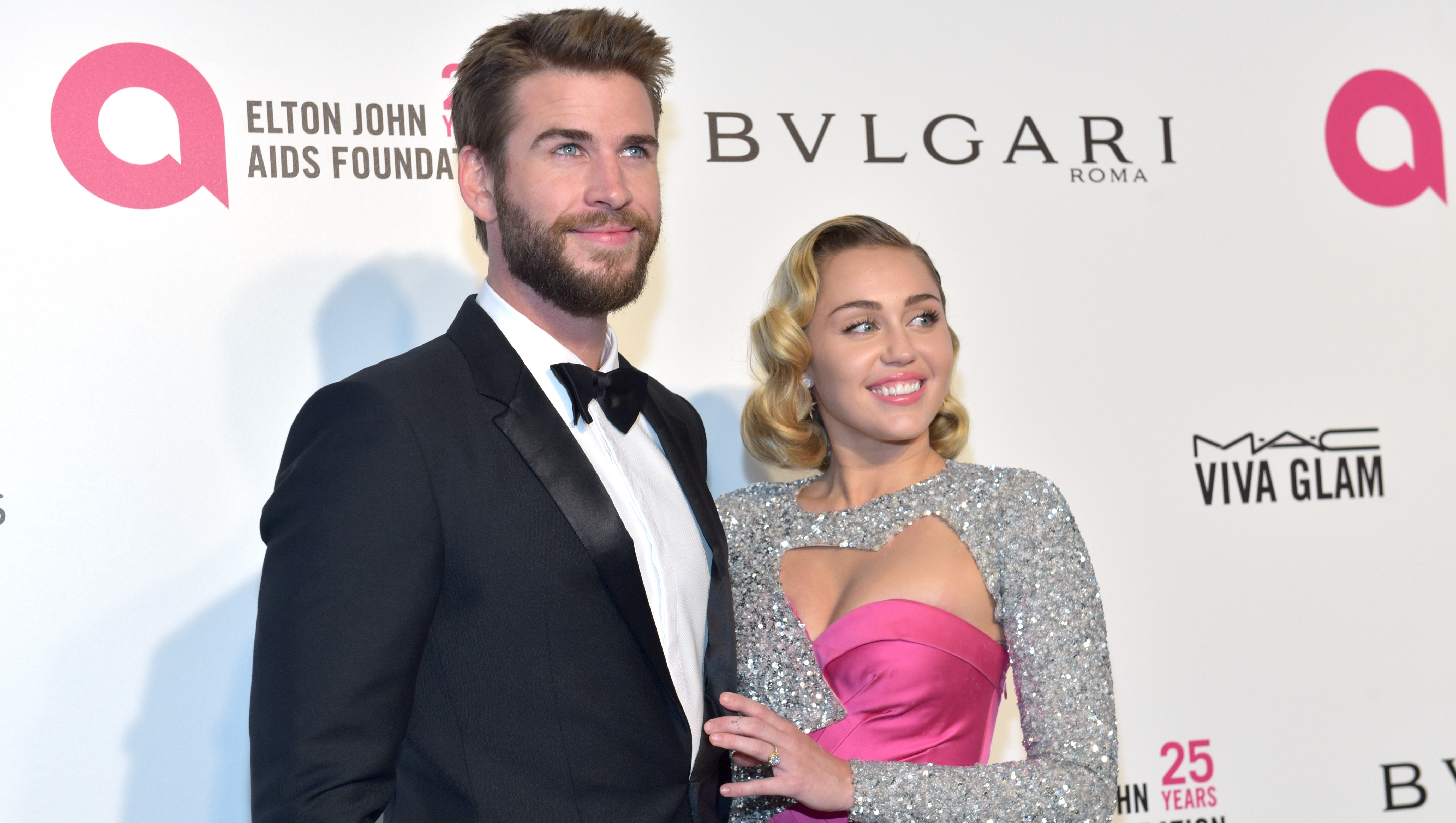 Liam Hemsworth, Tuxedo, Miley Cyrus, Pink and Silver Gown, Posing, Smiling