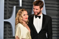 Miley Cyrus, Liam Hemsworth, Tuxedo, Gold Dress, Smiling