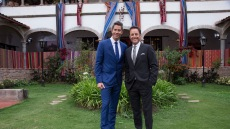 Chris Harrison with Arie Jr., wearing suits