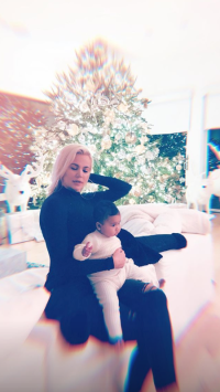 Khloe and True with Christmas tree