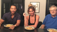 Chrissy Teigen, John Legend, with her dad, Ron eating something