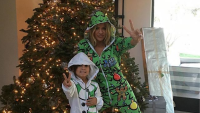 Khloe Kardashian and Mason Disick dressed up in onesies