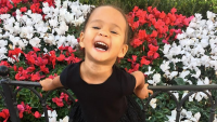 Chrissy Teigen's Daughter, Luna, Posing, Flowers, Black Dress, Smiling