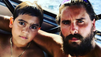 Scott and Mason Disick On A Boat