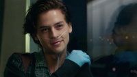 Cole Sprouse smiling in the movie 5 Feet Apart with a breathing tube in his nose