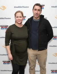 Amy Schumer and husband posing