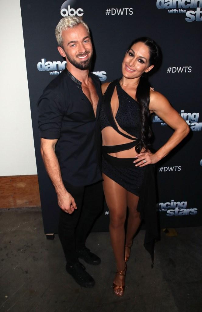 Nikki Bella posing with her Dancing With the Stars partner Artem Chigvintsev