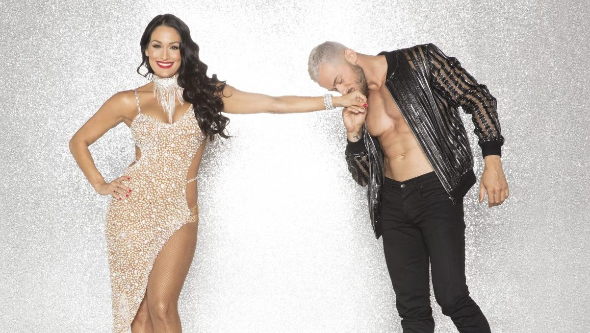 Nikki Bella posing with her Dancing With the Stars partner Artem Chigvintsev