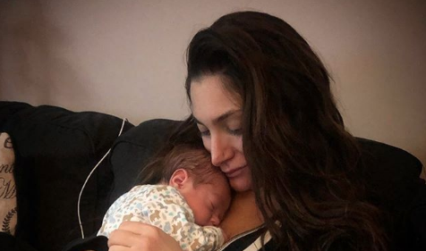 Deena Cortese holding her newborn baby
