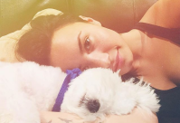 Demi Lovato laying down with her late dog Buddy
