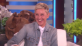 Ellen DeGeneres laughing wearing a jean jacket and white shirt