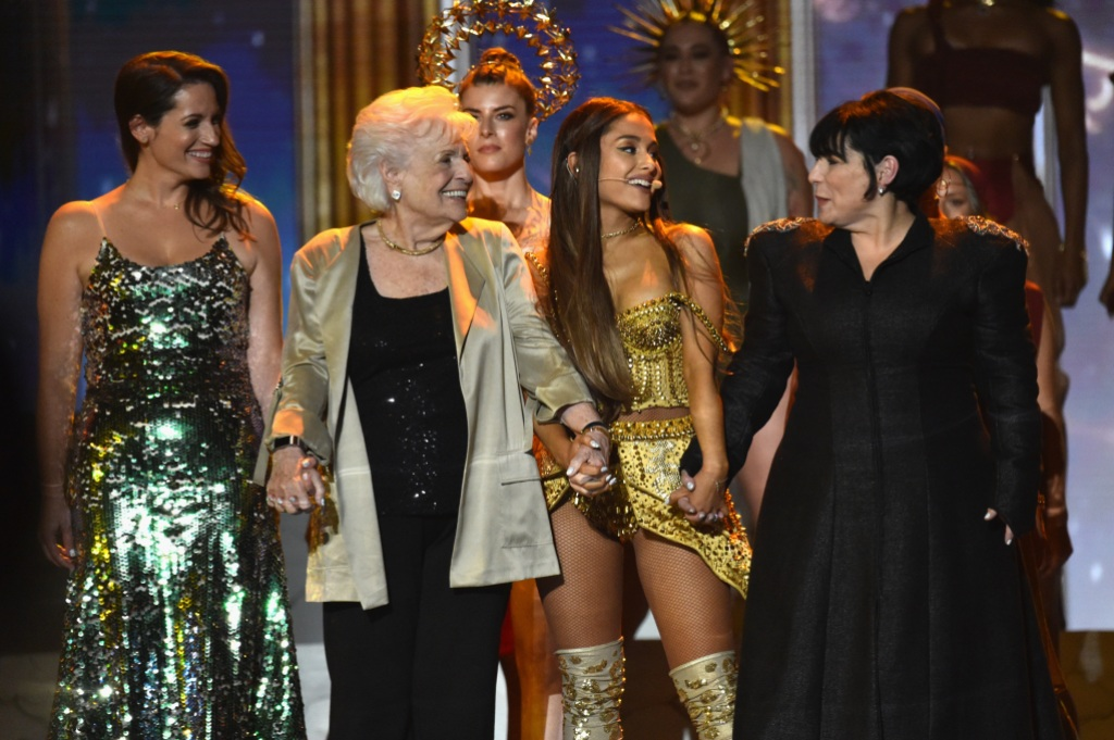 Ariana Grande on stage with her mom, grandma, and aunt