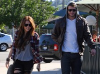 Miley cyrus wears flannel shirt while out with Liam hemsworth in a leather jacket and hoodie