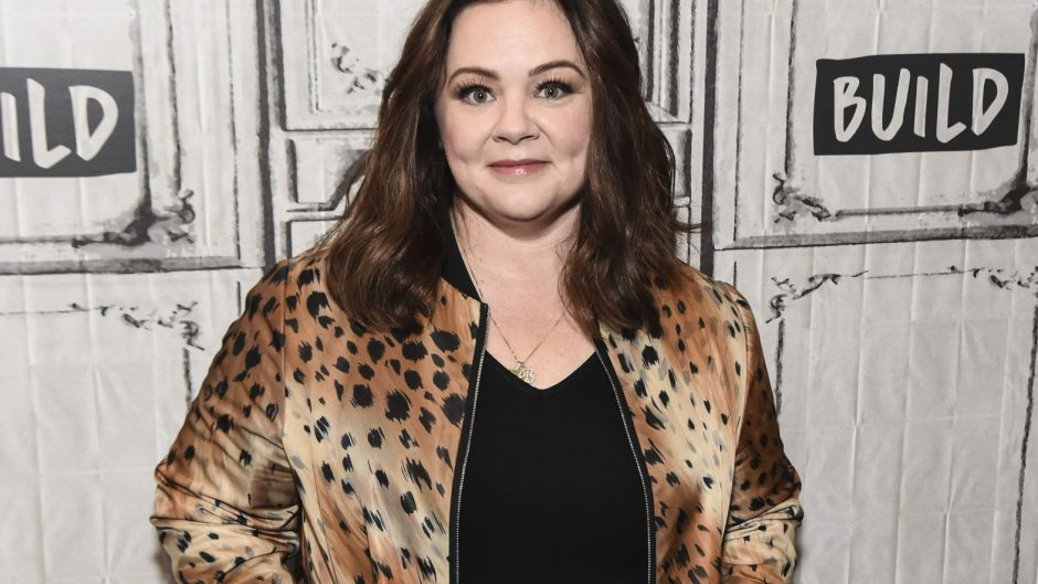 Melissa McCarthy posing in a cheetah print jacket