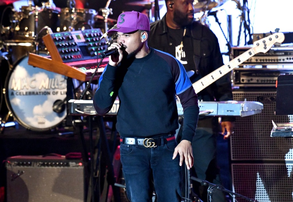 Chance the Rapper singing in a purple hat