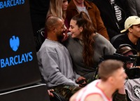 Ashley Graham kissing her husband Justin Ervin