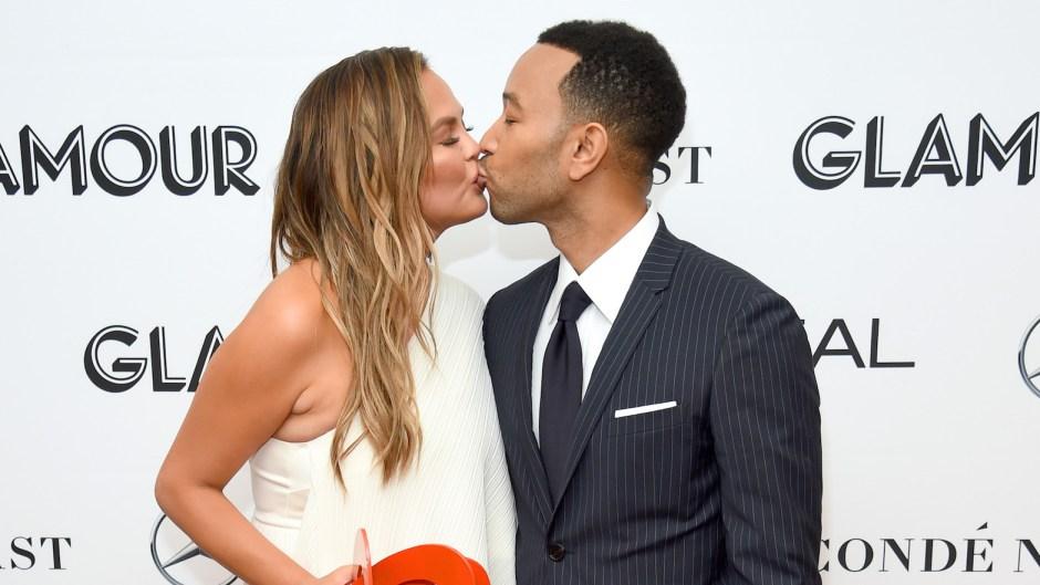 Chrissy Teigen kissing John Legend