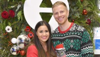 Sean Lowe wearing a Christmas sweater with wife Catherine Giudici