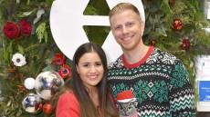 Sean Lowe wearing a Christmas sweater with wife Catherine Giudici