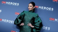 Shay Mitchell wearing a green dress at an event