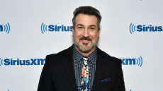 Joey Fatone wearing a suit at Sirius XM