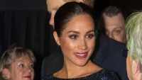 Meghan Markle wearing red lipstick