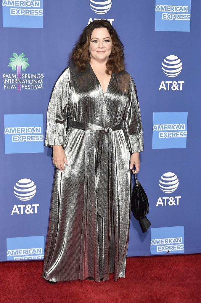 Melissa McCarthy posing in a silver dress