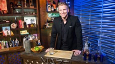 Sean Lowe wearing a black suit at Watch What Happens Live