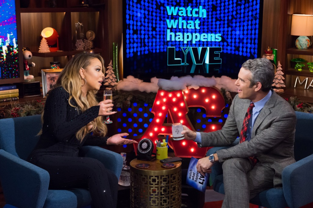 Mariah Carey drinking champagne with Andy Cohen
