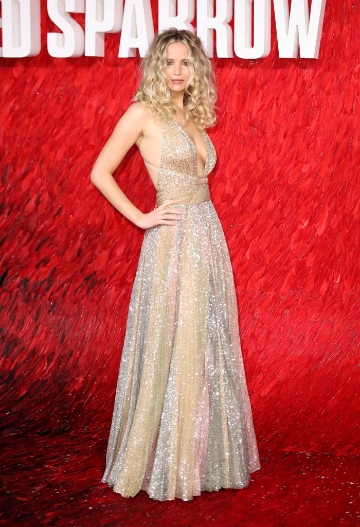 Jennifer Lawrence posing in multi-colored gown