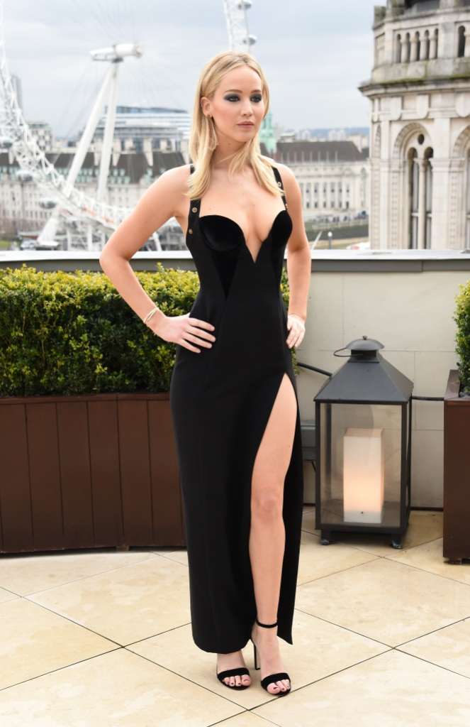 Jennifer Lawerence posing in a low-cut black gown