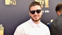 Vinny Guadagnino wearing sunglasses and a white shirt