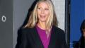 Gwyneth Paltrow walking in NYC wearing a purple sweater and black blazer