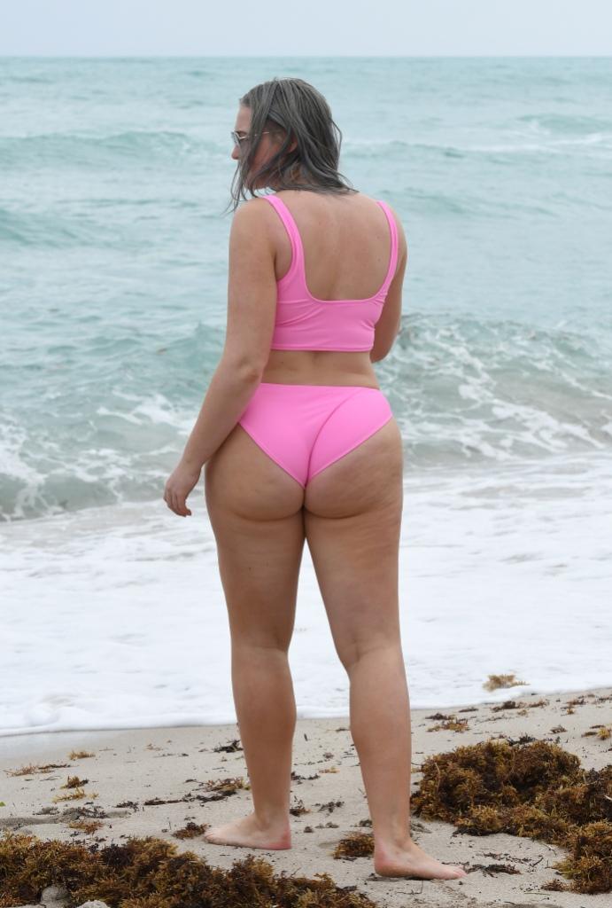 Iskra Lawrence in a pink bikini on the beach
