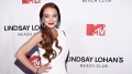 Lindsay Lohan Poses In White Dress At MTV Premiere