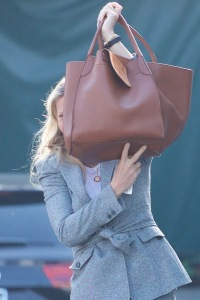 Gwyneth Paltrow trying to hide her face with her bag