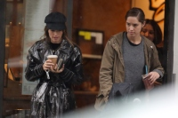 Katherine Schwarzenegger shows of her engagement ring while out to breakfast with sister Christina.
