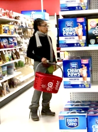 Meghan Markle's mom Doria Ragland shopping at target wearing jeans, a blue sweater, and white scarf