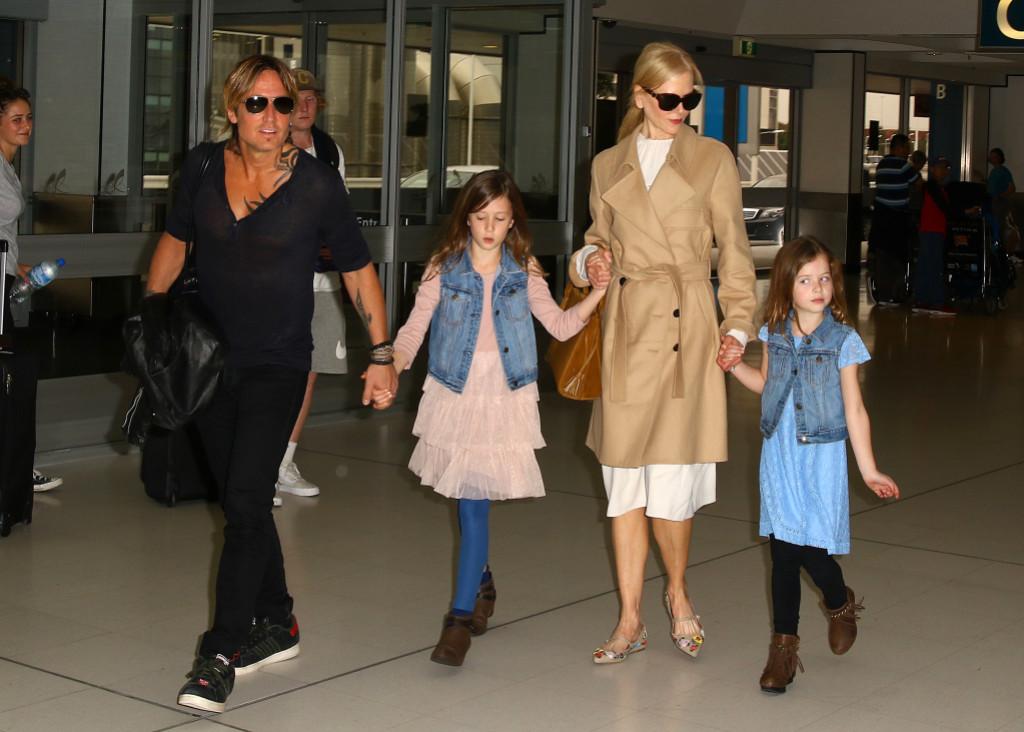 Keith Urban and Nicole Kidman walking with their kids