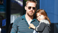 Ryan Gosling walking with his daughter