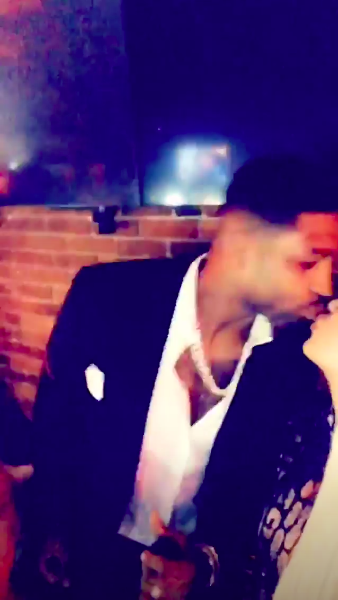 Khloe Kardashian and Tristan Thompson kissing on New Year's