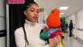 Jordyn Woods holding Stormi Webster at a Travis Scott concert